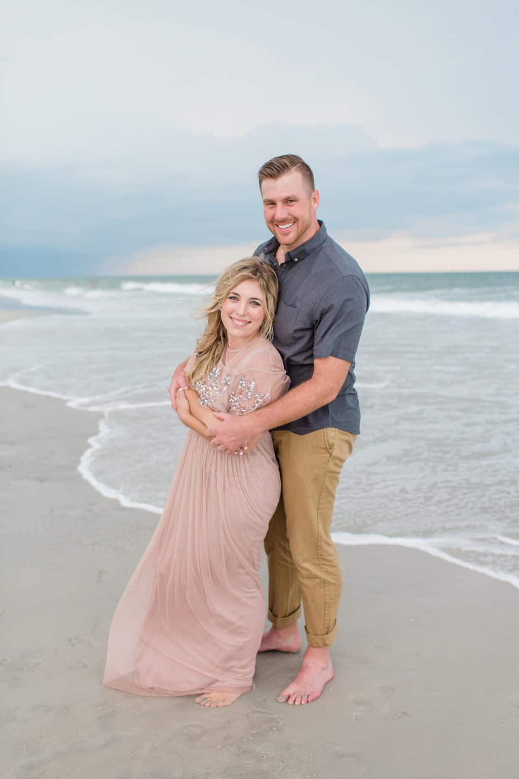 couple on the beach in fancy outfits