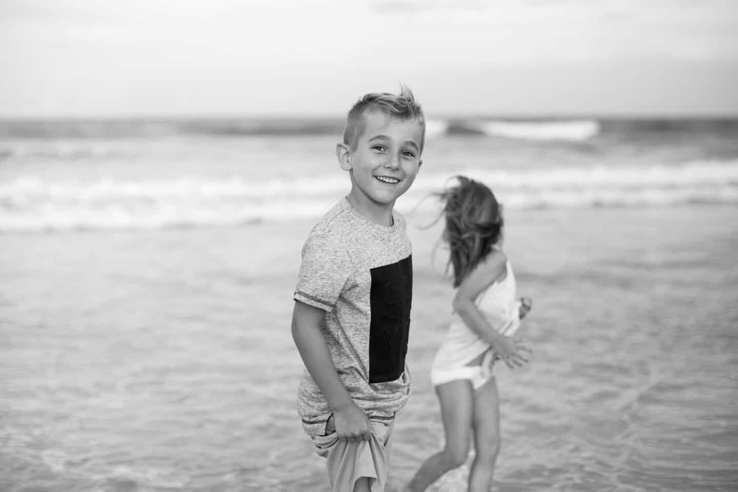 boy playing on beach professional beach family photography
